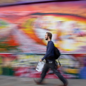 hipster-walking-past-a-mural-in-san-francisco